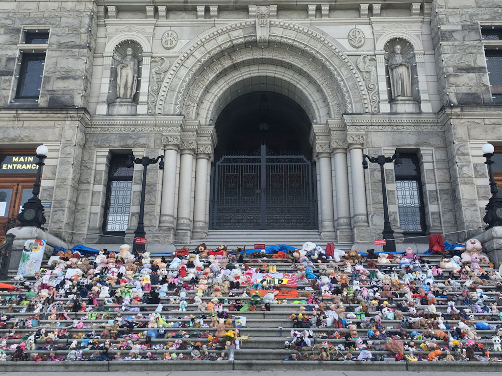 Victoria BC parliament building steps covered in toys for Truth and Reconciliation day in honour of the first nations children