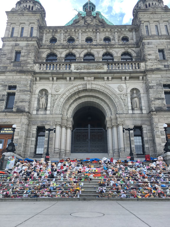legislative steps of Victoria BC parliament buildings covered in toys and shoes for the first nations children on truth and reconcillation day