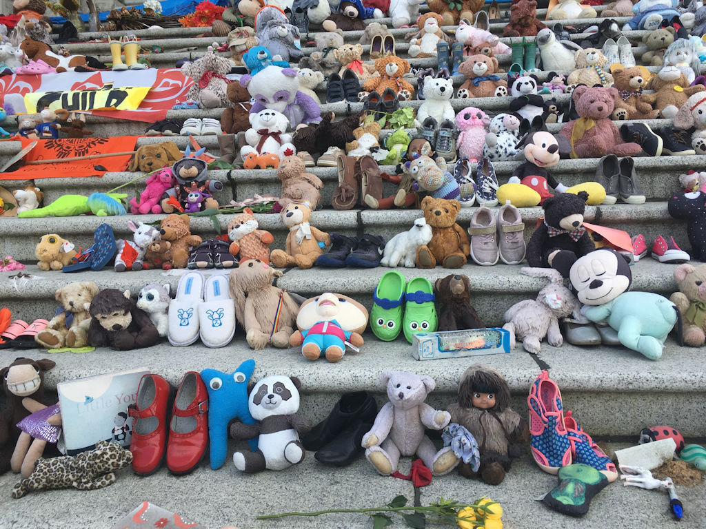 close up of the toys left on the parliament building steps in honour of the first nations children on truth and reconicilliation day british columbia